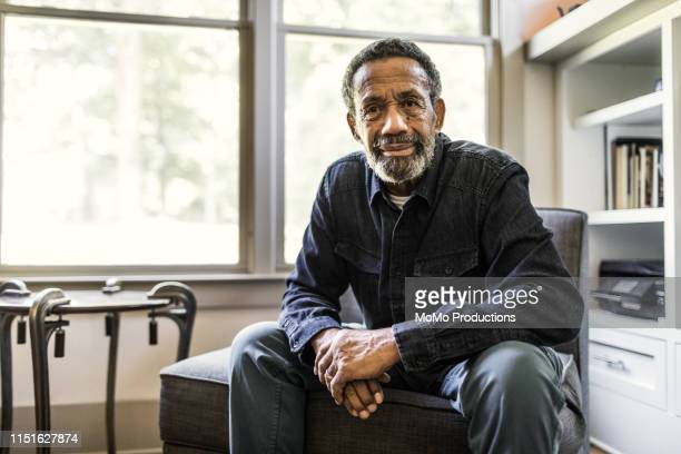 portrait of senior man at home - african ethnicity stock pictures, royalty-free photos & images