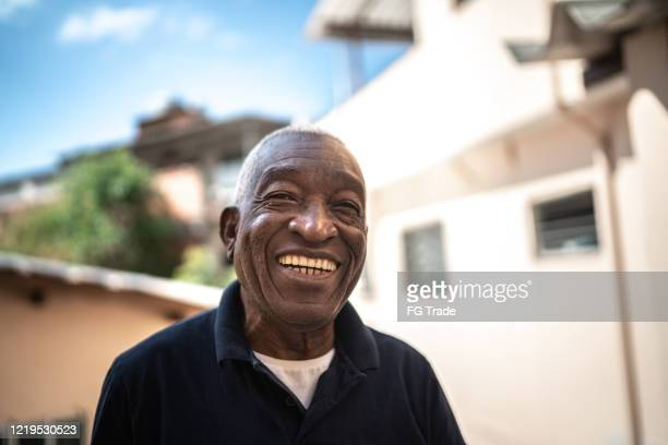 portrait of senior man at house - brazilian ethnicity stock pictures, royalty-free photos & images