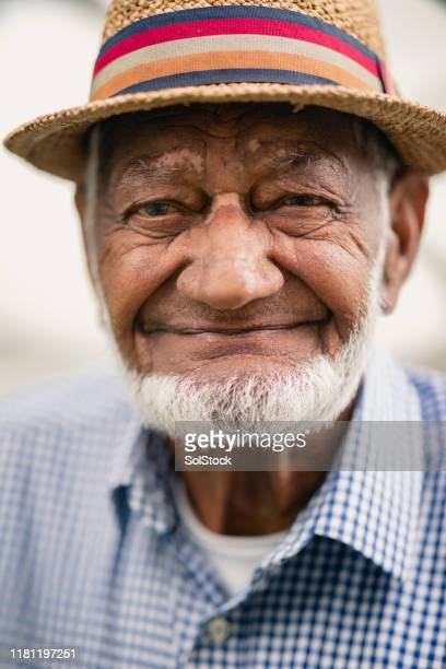 portrait of senior man beaming with pride - cleveland stock pictures, royalty-free photos & images