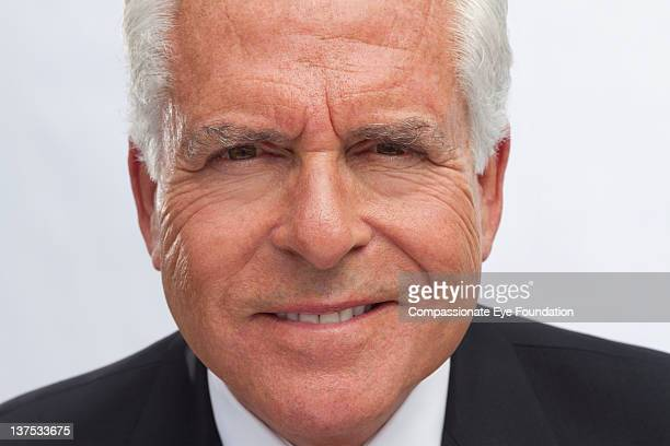 """portrait of senior man, close up, smiling - """"compassionate eye"""" stock pictures, royalty-free photos & images"""
