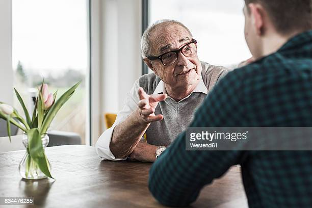 Portrait of senior man communicating with his grandson