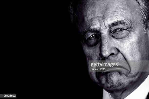 portrait of senior man frowning, black and white - dictator stock pictures, royalty-free photos & images