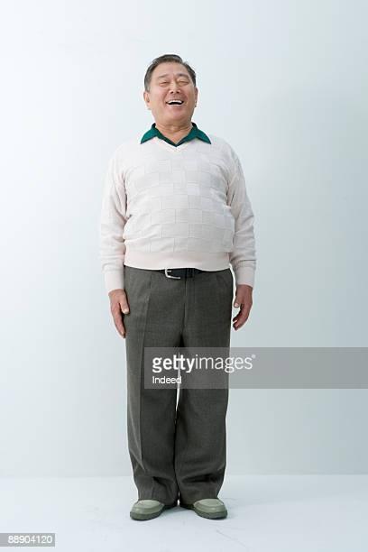 Portrait of senior man, full length