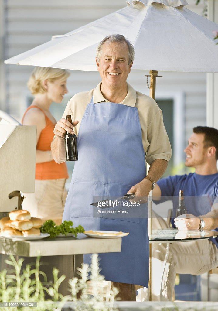 Portrait of senior man grilling : Foto stock