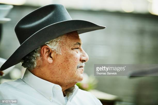 portrait of senior man in cowboy hat - texas independence day stock pictures, royalty-free photos & images
