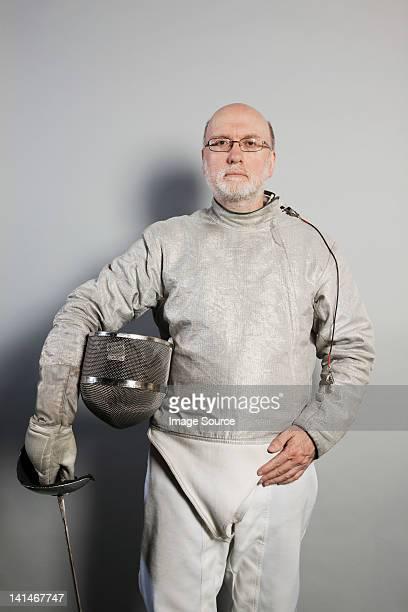 Portrait of senior man in fencing suit