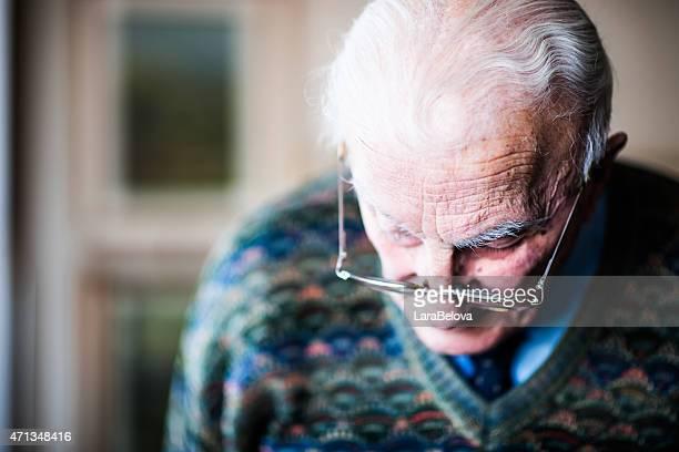 Portrait of senior man looking down