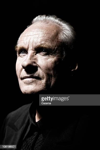 Portrait of Senior Man, Low Key on Black Background