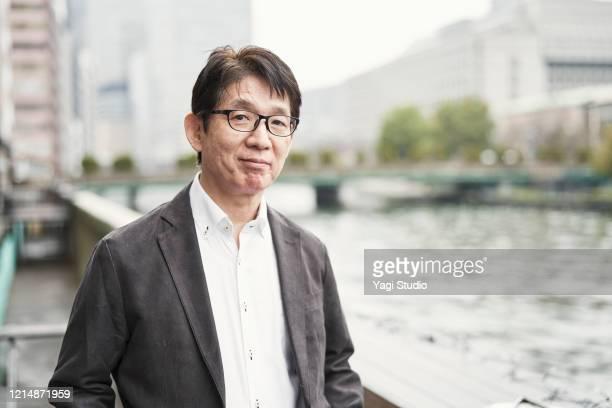 portrait of senior man on cafe terrace - 60代 ストックフォトと画像