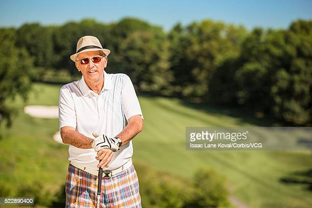 Portrait of senior man on golf course