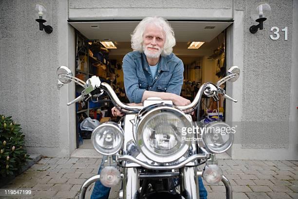 Portrait of senior man on vintage motorbike