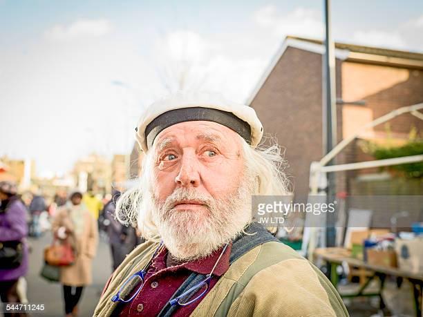 portrait of senior man outdoors - セーラーハット ストックフォトと画像
