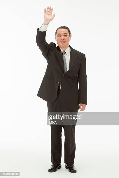 portrait of senior man - 手を挙げる ストックフォトと画像