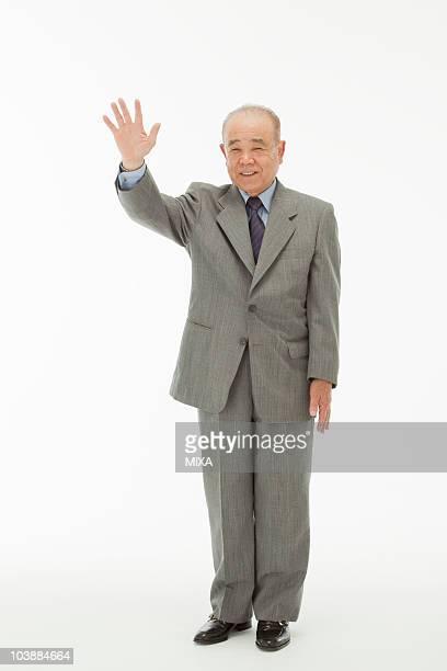 portrait of senior man - 手を振る ストックフォトと画像