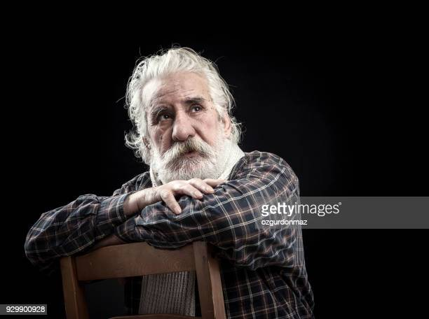 portrait of senior man - arab old man stock pictures, royalty-free photos & images