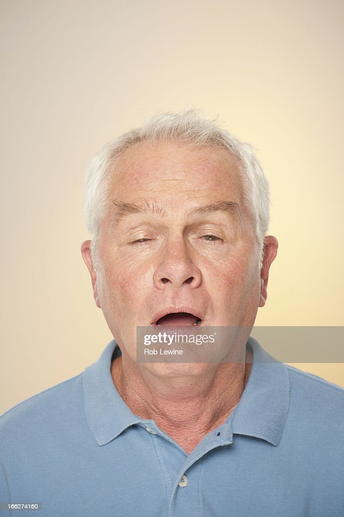 Portrait of senior man pulling funny face : Stock Photo