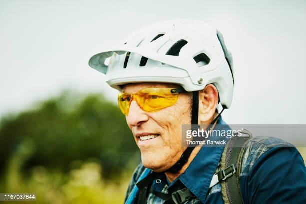 Portrait of senior man resting during mountain bike ride