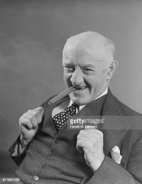portrait of senior man smoking - neckwear stock pictures, royalty-free photos & images