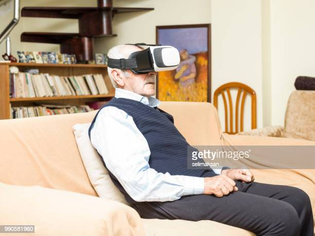 Portrait Of Senior man Using VR Headset