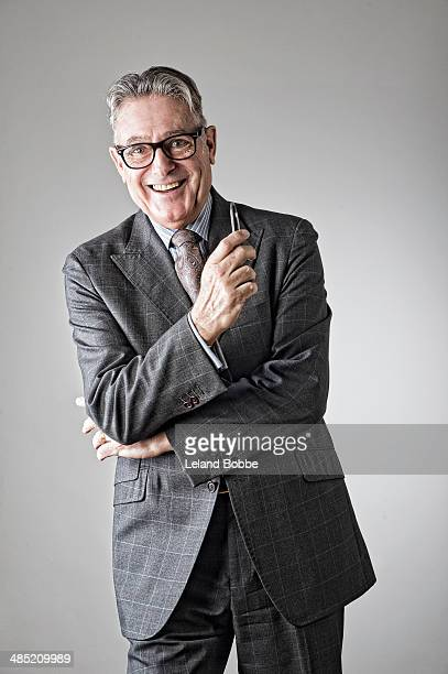 Portrait of senior man, wearing suit