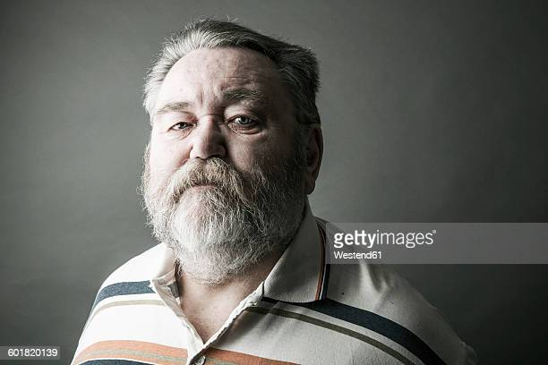 Portrait of senior man with full beard