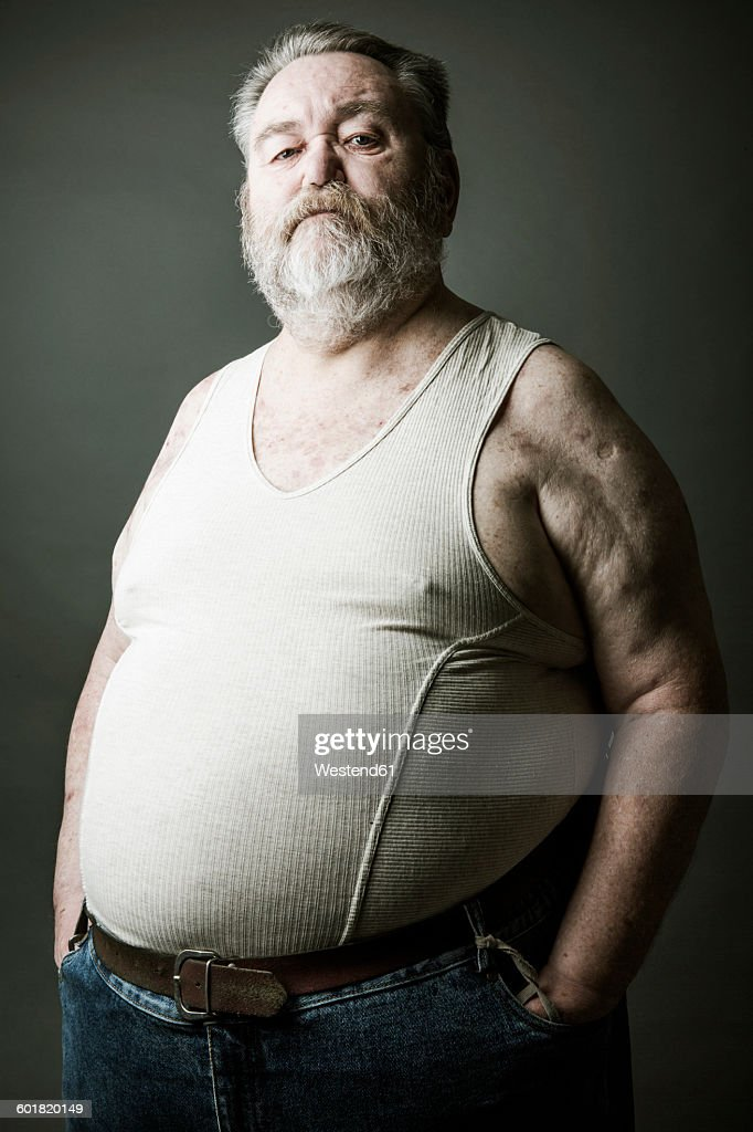 Portrait of senior man with full beard wearing vest : Stock Photo