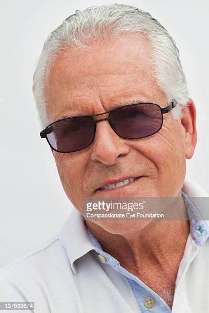 Portrait of senior man with sunglasses, smiling
