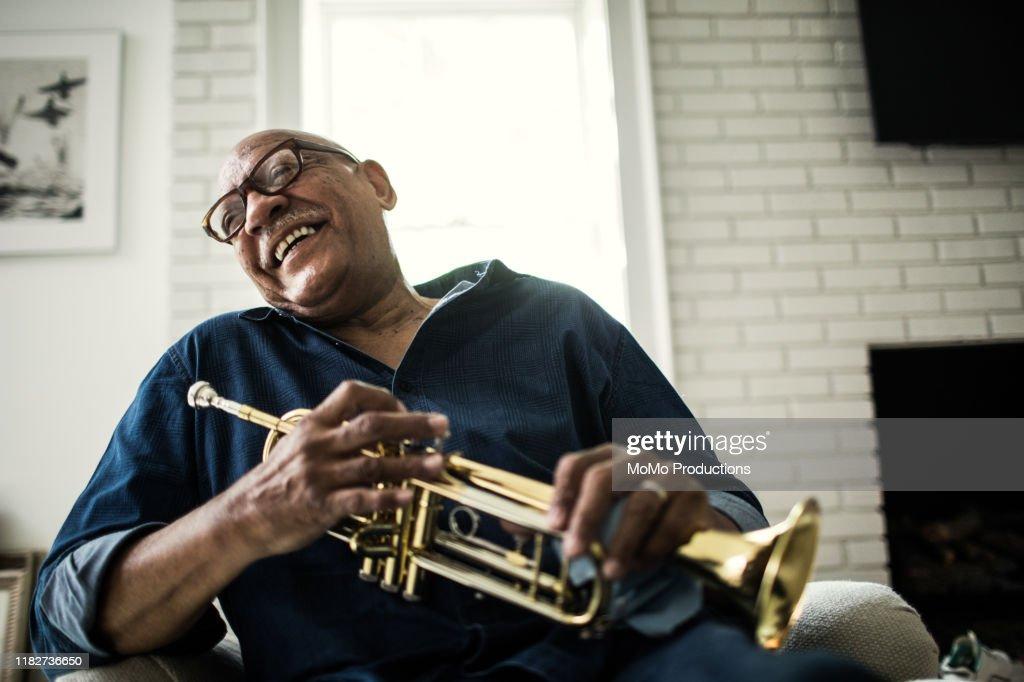 Portrait of senior man with trumpet : Stock Photo