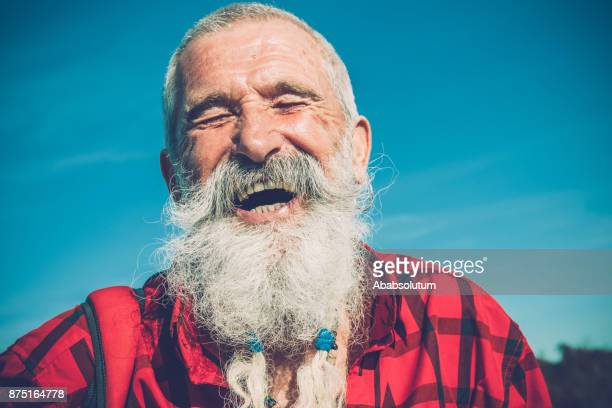 portrait of senior man with white beard and moustaches hiking in southern julian alps, europe - beard stock pictures, royalty-free photos & images