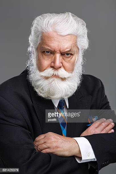 Portrait of senior man with white beard and mustache