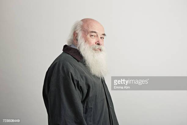 portrait of senior man with white beard - beard stock pictures, royalty-free photos & images