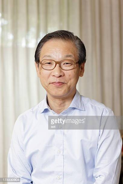 portrait of senior man,smiling - 60代 ストックフォトと画像