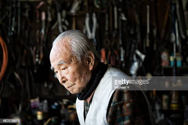 Portrait of senior mechanic  in his factry