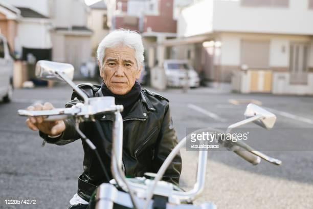 portrait of senior moto enthusiast - biker jacket stock pictures, royalty-free photos & images