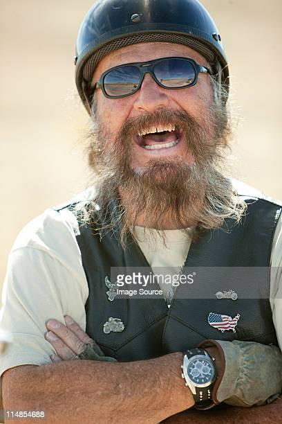 Portrait of senior motorcyclist laughing