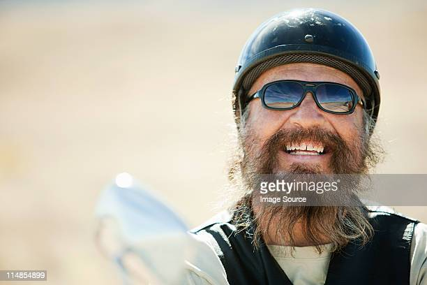 Portrait of senior motorcyclist laughing