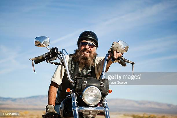 portrait of senior motorcyclist - motorcycle stock pictures, royalty-free photos & images