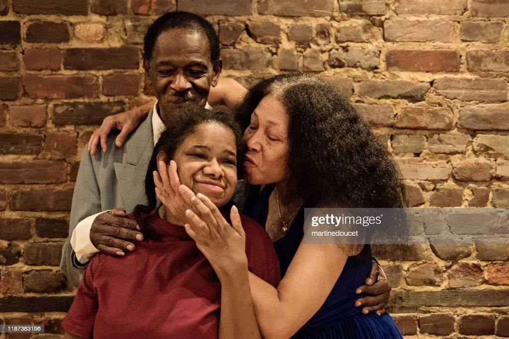 Portrait of senior parents with disable adult daughter. : Stock Photo