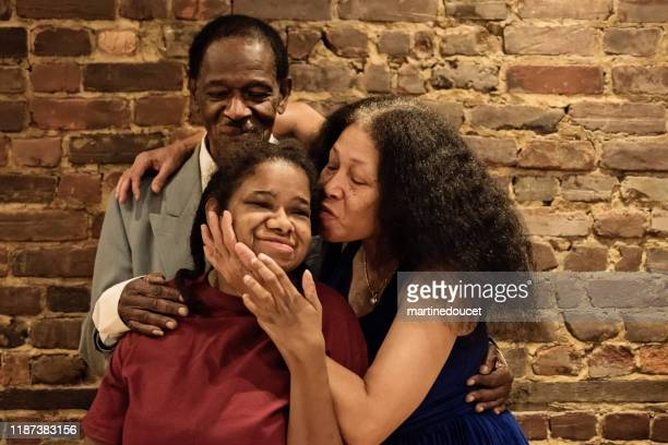 """portrait of senior parents with disable adult daughter. - """"martine doucet"""" or martinedoucet stock pictures, royalty-free photos & images"""