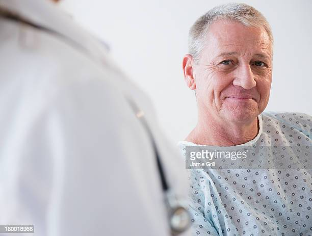 portrait of senior patient - hospital gown stock pictures, royalty-free photos & images