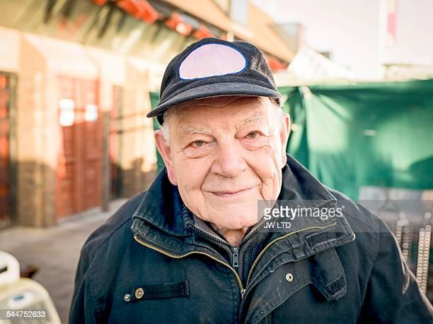 Portrait of senior smiling to camera, urban enviro