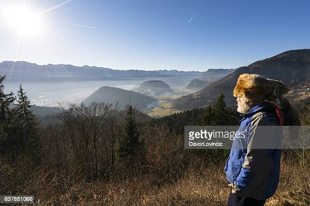 Portrait of senior with Kuchma on mountain's sun shine