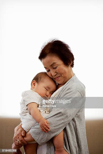 portrait of senior woman and  her grandchild