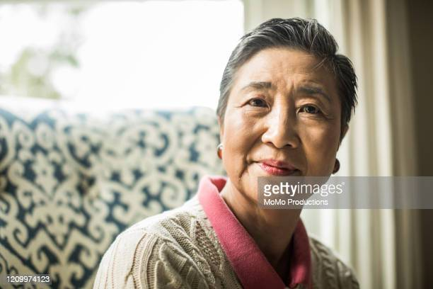 portrait of senior woman at home - east asian ethnicity stock pictures, royalty-free photos & images