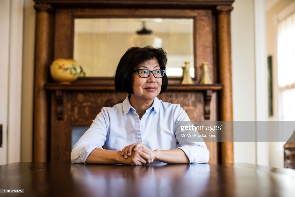 Portrait of senior woman at home : Stock Photo