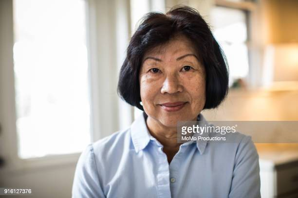 portrait of senior woman at home - asian and indian ethnicities stock pictures, royalty-free photos & images