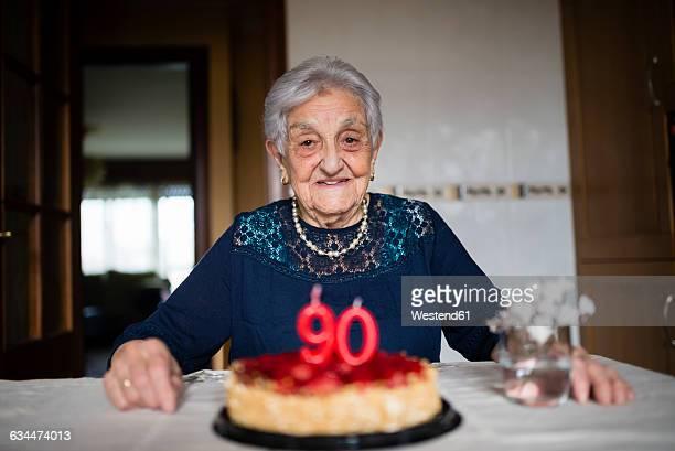 Portrait of senior woman celebrating her ninetieth birthday