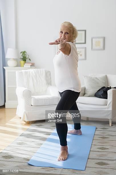 Portrait of senior woman doing yoga