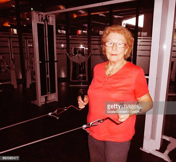 Portrait Of Senior Woman Exercising In Gym