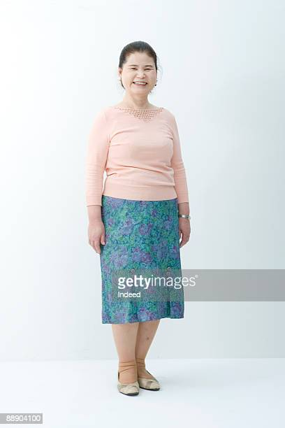 portrait of senior woman, full length - skirt stock pictures, royalty-free photos & images